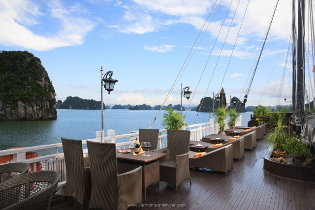 Relaxing on sundeck Halong boat