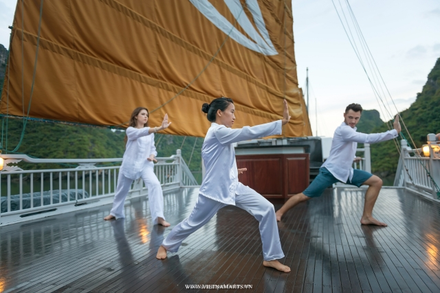 Morning Tai chi on boat Halong bay